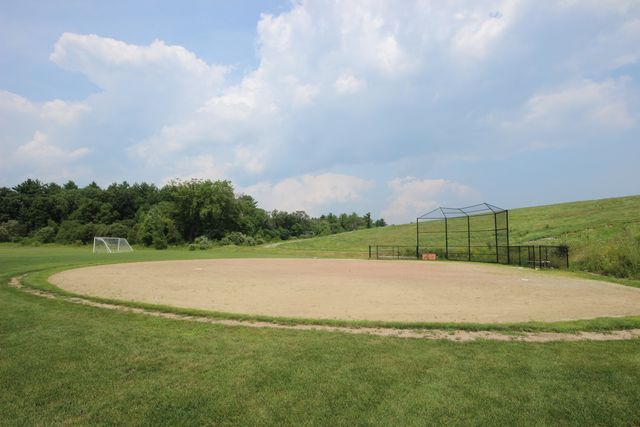 Softball field with cage