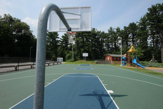 Basketball court beside playground