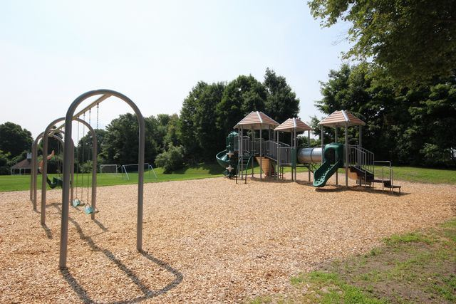 Playground with swings and jungle gym